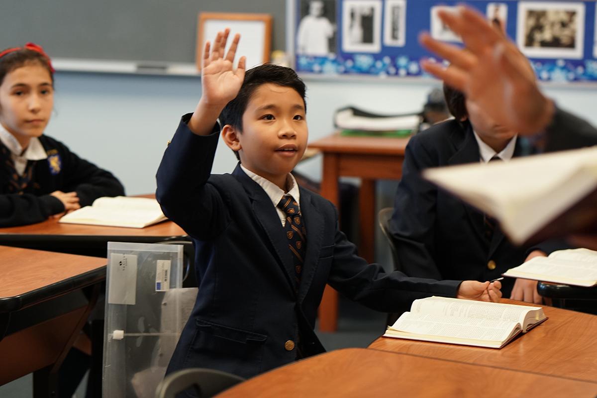 student raising hand 1200