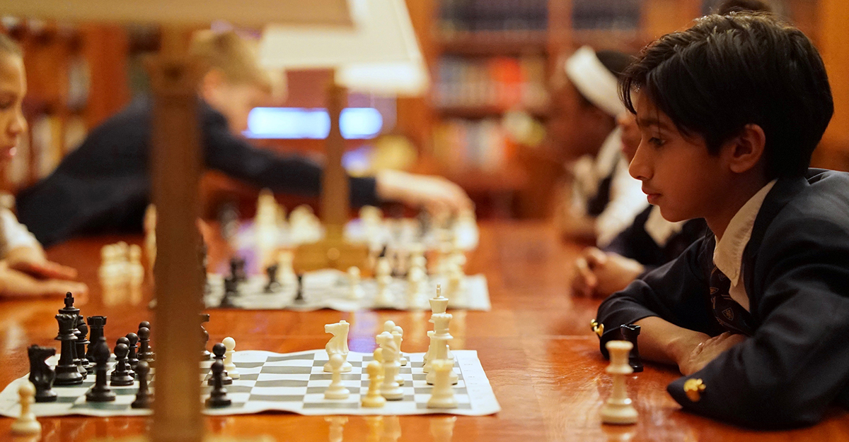 students playing chess 1200