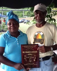 2012 Farmer of the Year Charles Leonard, right, and his helpmate, Jeanne Delsoin.