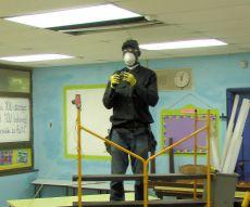 Worker changes energy saving light bulbs at Arthur Richards School.