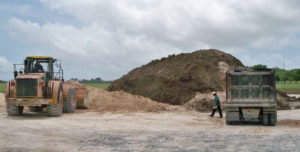 Workers prepare the ground for the UVI Medical School Simulation Center on St. Croix. (Carol Buchanan photo)