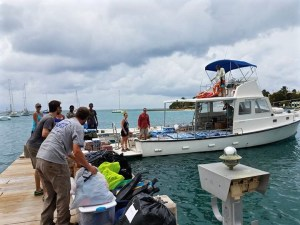 Crucians help load Matt Ridgeways boat with supplies for St. Thomas. (Photo from Facebook)