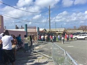 St. Croix residents wait for food and water at Juanita Gardine Elementary on Saturday. (Marina Leonard photo)
