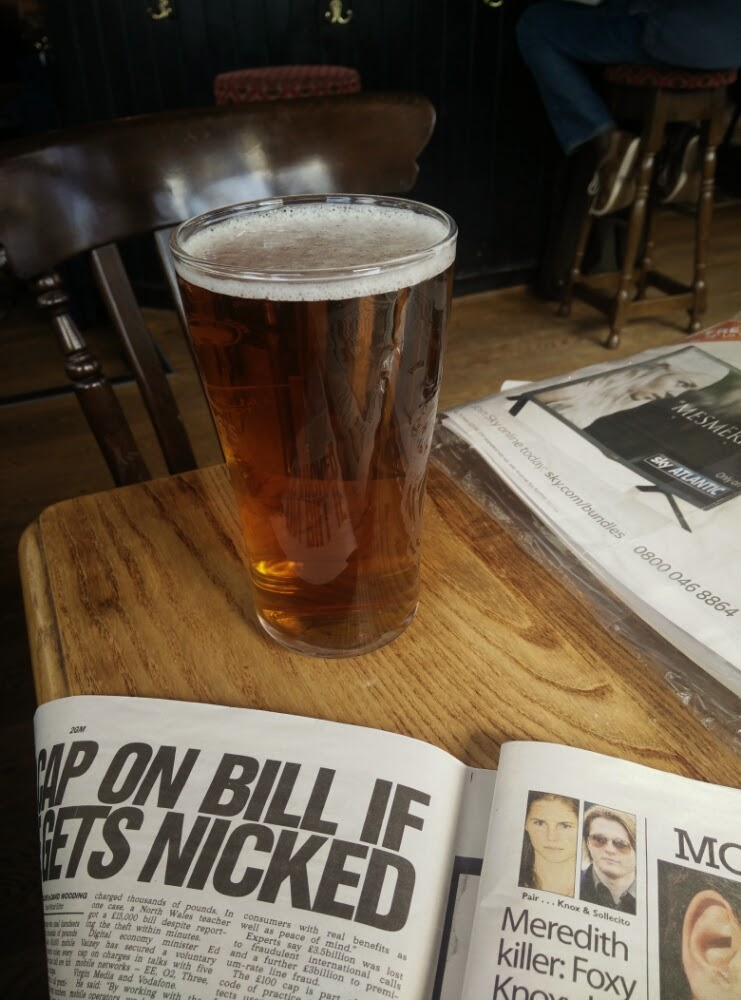 A well earned pint and a ready of the Sunday papers after the Richmond Half.