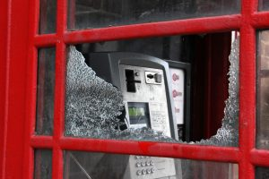 Vandalised red phone box photo