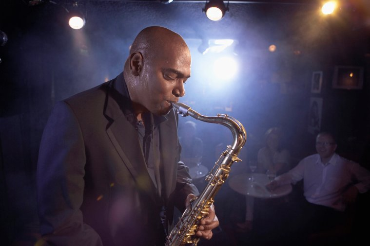 Creative PR content saxophonist in a jazz club photo