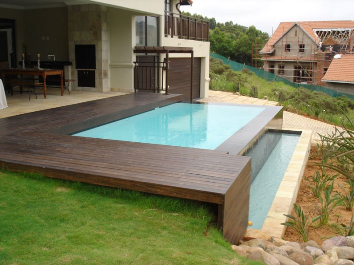 TIMBER-DECK-BLACK-TILES-TO-POOL-AND-SPILLWAY-TOP