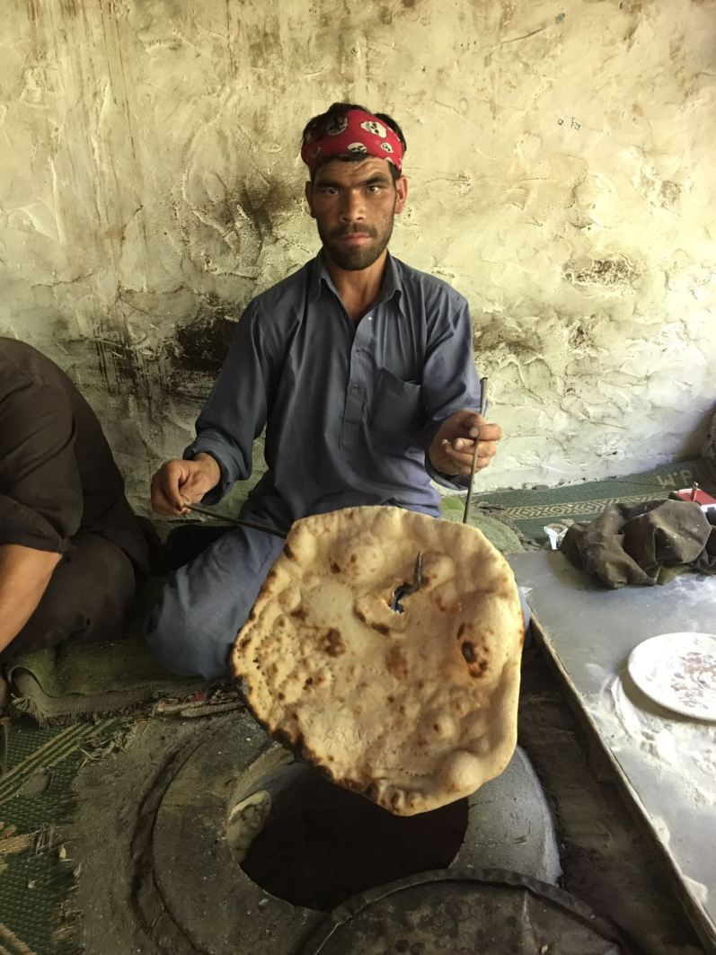 Bingo, a cooked chapatti. There is another Bingo cooking on the inside of the oven wall.