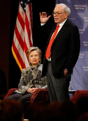 """SAN FRANCISCO - DECEMBER 11: Billionaire investor Warren Buffett talks as Democratic presidential hopeful Hillary Clinton listens onstage at a fund-raising event December 11, 2007 in San Francisco, California. The junior U.S. senator from New York was joined by Buffet, who has not endorsed Clinton and has also hosted a fundraiser for Clinton's chief rival for the Democratic nomination, Sen. Barack Obama of Illinois. Buffet has called both candidates """"presidential."""" (Photo by Justin Sullivan/Getty Images)"""