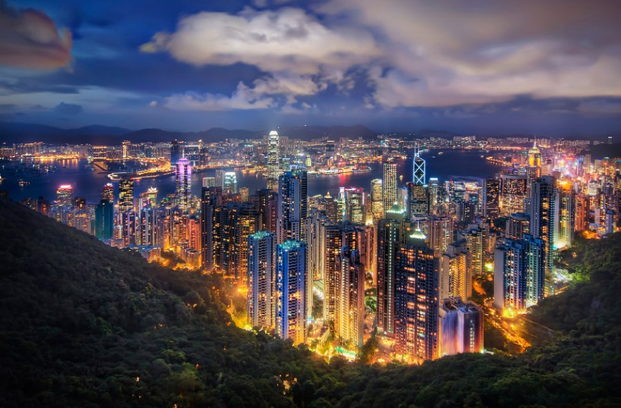 Hong Kong from the Peak on a Summer's Night If you want to see how I made this (and how you can too!), visit my HDR Tutorial. I hope it gives you some new tricks!I had a long day waking up at 5 AM to take a series of subways and trains up to Shenzen for some meetings. I had a Chinese VISA, which you don't need to get into Hong Kong, but I had to use to cross the official Chinese border after getting off the train. I didn't realize that it was a one-time use VISA, and I had to go to Shanghai the next day. This caused a lot of problems with the Chinese officials, a body of government with which I do not enjoy causing problems.Anyway, after I got back to Hong Kong after a day in Shenzen, I was hot and sweaty and in the sort of meeting clothes that aren't great for being hot and sweaty in. But, everything about Hong Kong was still awesome and I had too look hard for things to complain about. The sun was setting, and I made it up to The Peak just in time for a shot.This was a 5-exposure HDR shot at 100 ISO, and, of course, a sturdy tripod to get all the lights as steady as possible.- Trey RatcliffClick here to read the rest of this post at the Stuck in Customs blog.