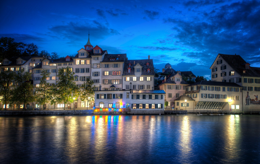 Zurich at NightIt was a cool night -- one of those nights when I was glad I lugged around a jacket all day.  These dark waters that run through old European cities at night set an interesting mood.  I can't quite put my finger on it...  heavy and deep and dark... but strange and light and reflective on top.  I think some of these things you can't quite see end up in the photo, somehow.- Trey RatcliffRead the rest here at the Stuck in Customs blog.