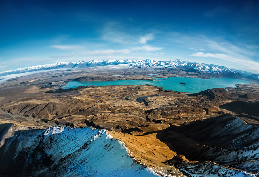 Over Lake Tekapo Here's one of my favorite images from that day in the chopper. Shooting from a helicopter is always tough. If you watched that video, you'll see I switched a lot between different cameras. Even though I am using the Sony NEX-7 a lot, I chose the Nikon here because of the extreme conditions. I was quite worried I would only get a few minutes to shoot, so I wanted to make sure I did not run into any buffering problems… this is why I went with the Nikon.Don't know what buffering is? That is what happens when you take a whole bunch of photos in a row and the camera has to save them quickly. On lesser cameras, sometimes you can only take a few photos before there is a long pause while it writes the photos. The NEX-7 lets met get in about 10-13 photos before it starts going slow. The Nikon D3s lets me take about 30+ I think!- Trey RatcliffClick here to read the rest of this post at the Stuck in Customs blog.