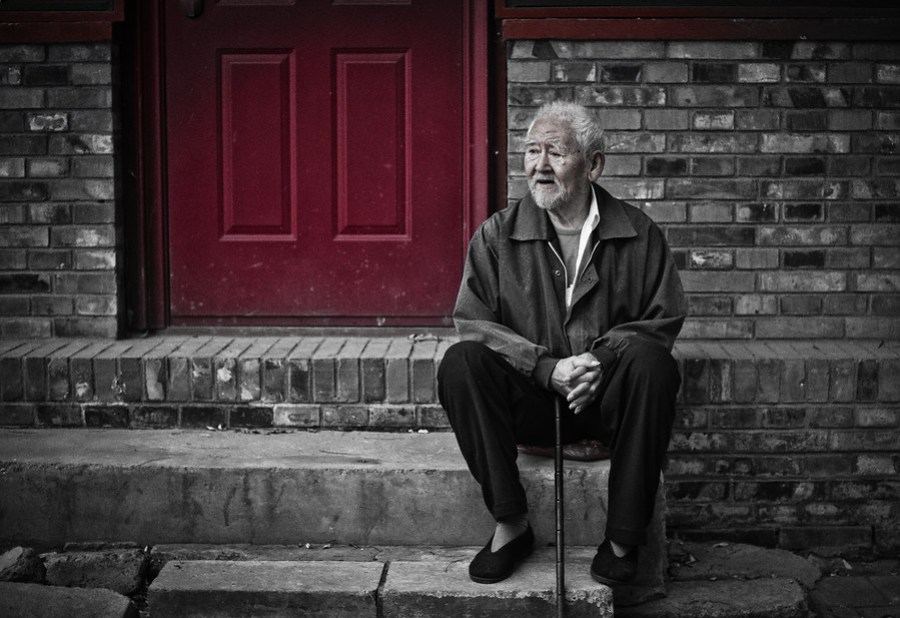 Old Man on Steps near Drum TowerWhile I was circling the Drum Tower in Beijing, there was a small community of people that were outside exercising, milling around, talking, and watching the world go by.  Many of the homes in the little houtong had their doors painted red, and that was a common element that tied everything together.  I had my hip-shooter with me too so I could capture this one.- Trey RatcliffClick here to read the rest of the post at the Stuck in Customs blog.