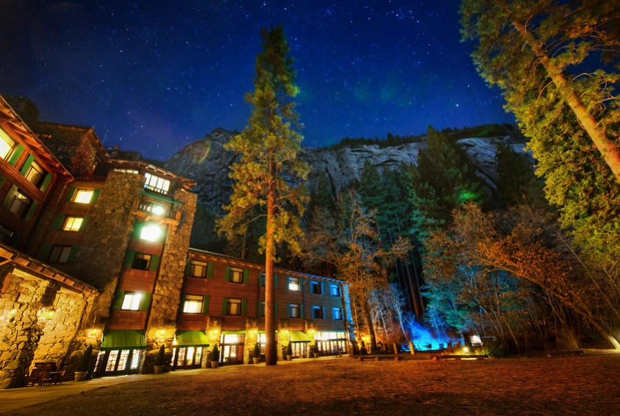 The Lodge at Night On the final night of the Yosemite PhotoWalk, we ended up here to explore the evening.  This is the Ahwahnee Hotel in Yosemite, and I hope I made it look as beautiful as it really is.  This is also the place that Steve Jobs got married.Karen Hutton and I arrived here very late at night after our extra-long walk!  We could even see a few people camping for the night halfway up the mountain they were climbing.  After going around the back side of the lodge, we saw the stars and trees and cliffs above...- Trey RatcliffClick here to read the rest of this post at the Stuck in Customs blog.