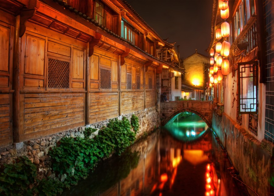 The Canals of Lijiang at NightThere must be a hundred little canals spread here and there through the old town.  There are so many opportunities for photos!  This is what we call a target-rich environment.This is the town I was in with Tom Anderson -- every night we explored a new area.  It was an amazing time... I can't wait to go back some day!- Trey RatcliffRead more here at the Stuck in Customs blog.