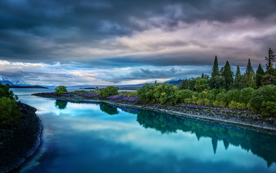 Evening on the blue Lake Tekapo Yes, these blues are real!I've gotten tens of thousands of messages from people that say that New Zealand is in their plans to visit in the near future, and when you visit this area, you'll see how crazy the colors really are. It's like The Sound of Music To The Next Order of Magnitude… everywhere.I've been adding this location and hundreds more to the free Stuck On Earth app — it should help you easily find these places when you eventually make it here! :) - Trey RatcliffClick here to read the rest of this post at the Stuck in Customs blog.