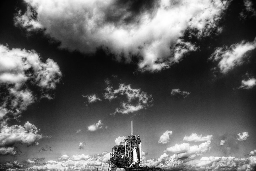 The Mighty Rocket Awaits Today I had a great day at NASA.  I've come back to the space coast in Florida to see the space shuttle Endeavor blast off, so I'm keeping my fingers crossed.Around noon, I was invited out with a group of other Twitter peeps to see the RRS Rollback event.  This is the slow-motion but exciting time when they peel away to the Rotating Service Structure to reveal the shuttle.  It was so awesome that I almost forgot to send a tweet. - Trey Ratcliff Read more here at stuckincustoms.com.