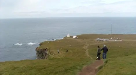 In the far distance is the light house at Látrabjarg.