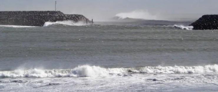 The waves of the North Atlantic Pound the Icelandic Coast at Landeyjarhöfn harbour