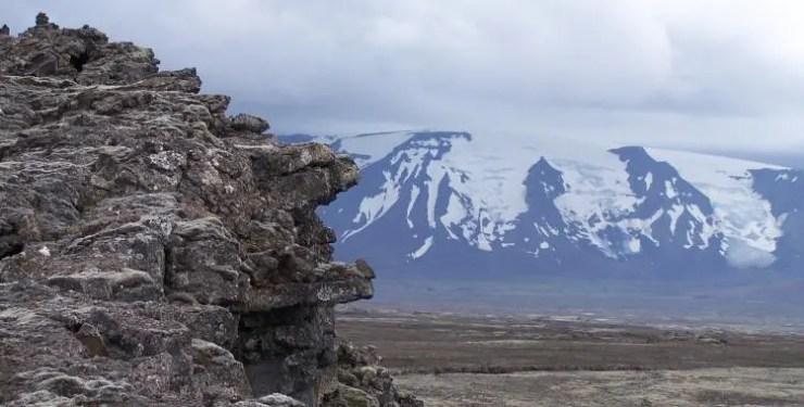 Gargoyles at Strýtur at the edge of the Kjalhraun lava field, The Langjokull glacier in the background.