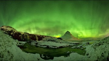 Like fireworks the northern lights in Iceland light up the sky above Kirkjufell.