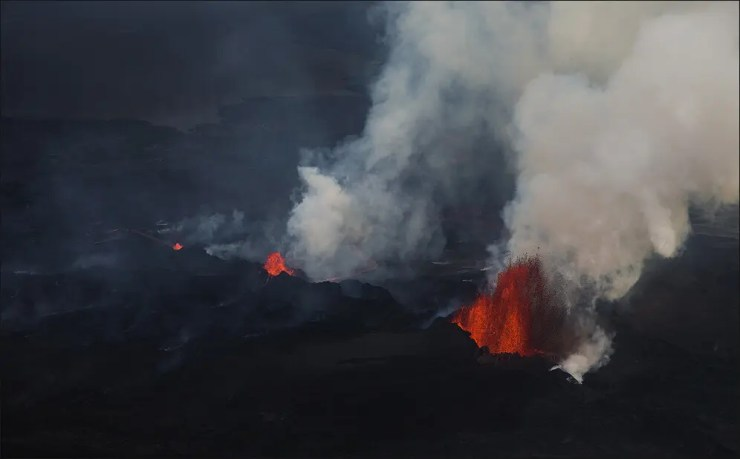 Poisonous fumes stream from the molten lava
