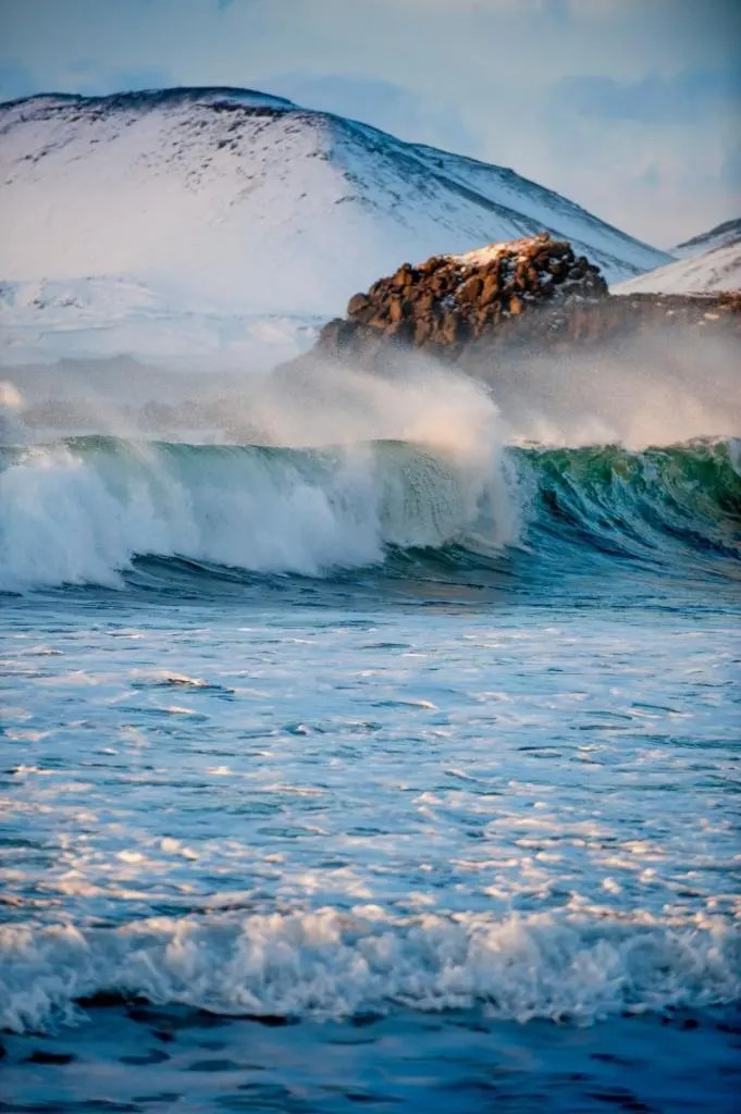 Mighty waves pound the southern coast of Iceland.