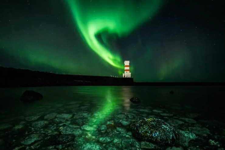 The Northern Lights Above Gardskagaviti Lighthouse.