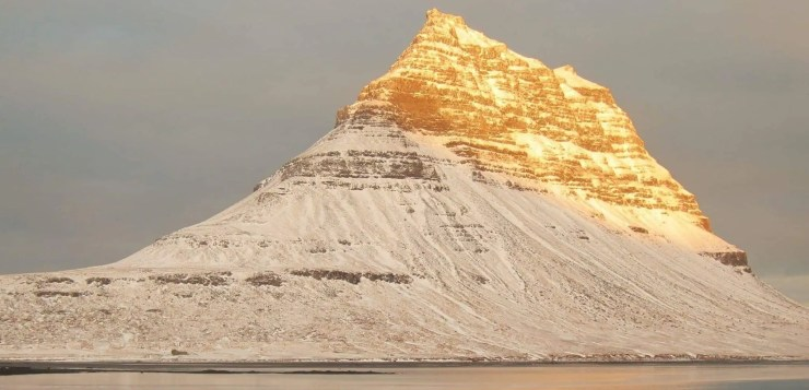Australian travel to Iceland. Heather D. Linnett took this photograph of Kirkjufell Mountain gilded by the sun.