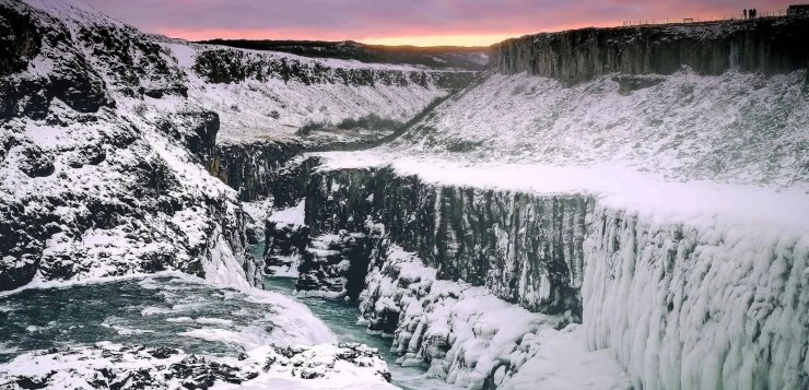 Combine the Golden Circle and snowmobiling. Here is Gullfoss waterfall in winter.