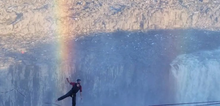 Slacklining above Dettifoss waterfall in Iceland.