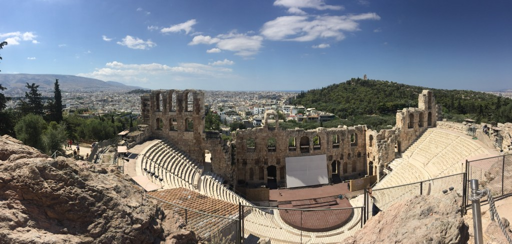The theater on the slope of the Acropolis. The city of Athens sprawled out in the background.