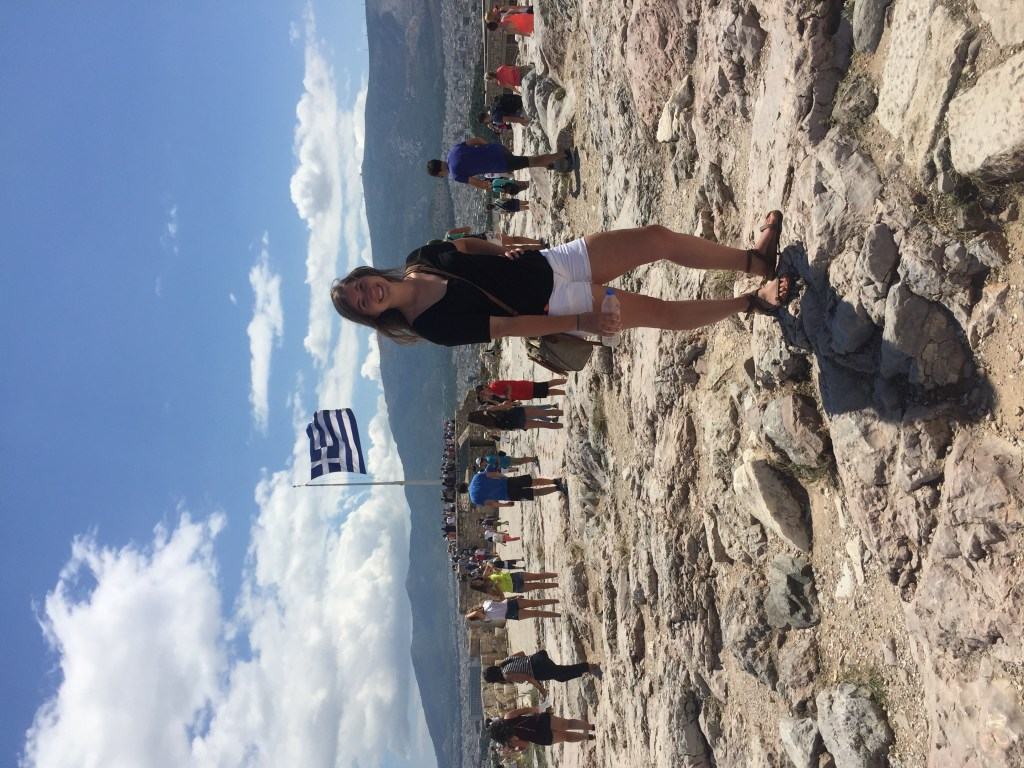 Me standing in front of the Greek flag at the top of the Acropolis. Excited for my 72 hours in Greece!