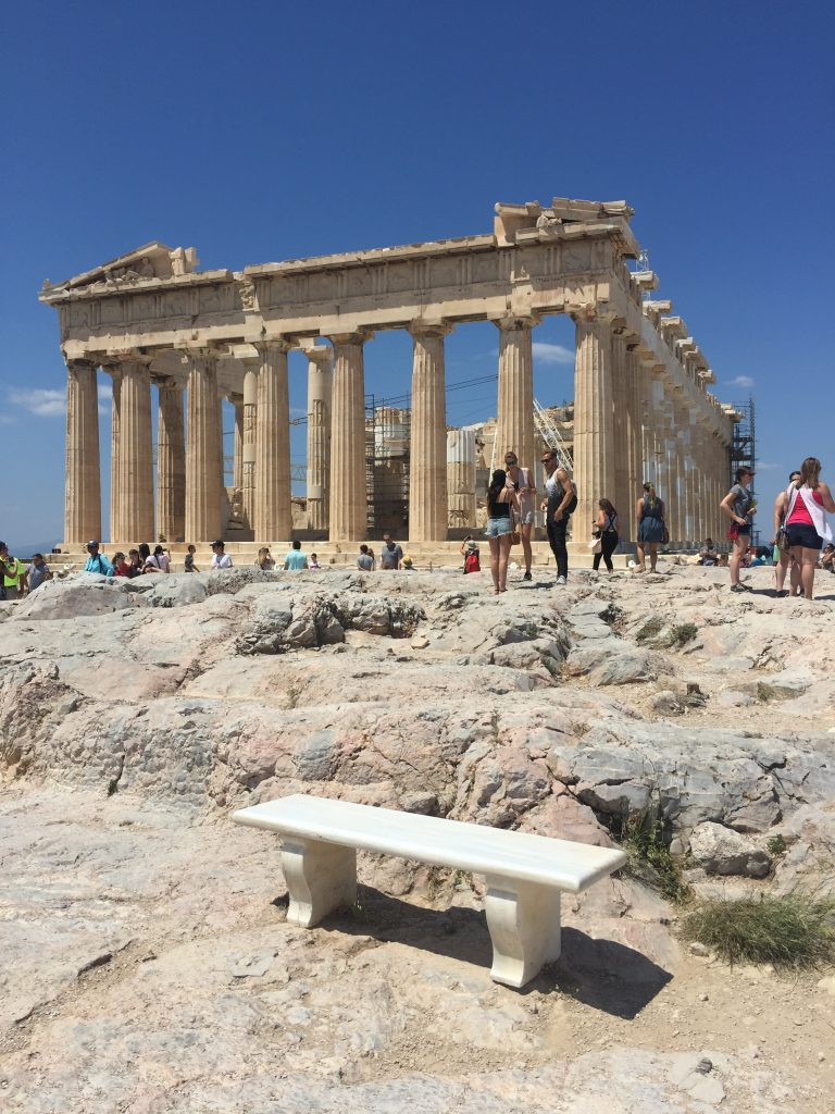 A bench in front of the Parthenon in Athens. Budget for your trip so you can see this.