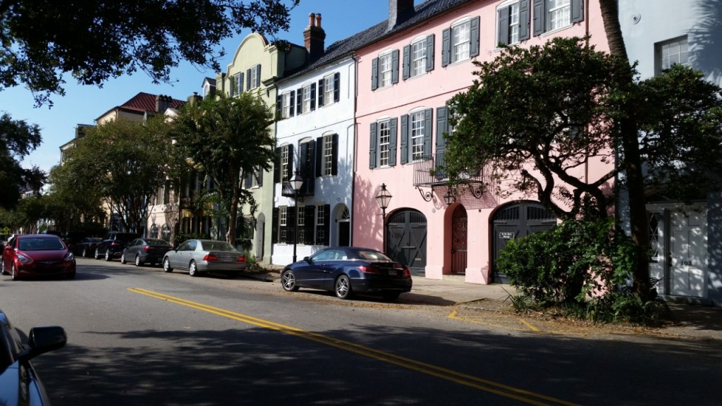Rainbow Row on East Bay Street. Trees and cars line the sidewalk. Perfect addition to the Charleston Photo Book.