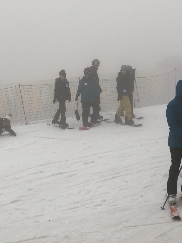 One of the most important snowboarding tips for beginners is to take a lesson! This shows my cousin in her lesson group on a white out day at Snowshoe Mountain.