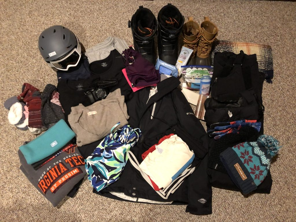 Every item that I pack for a ski vacation laid out on the floor before I put it in my board and boot bag.