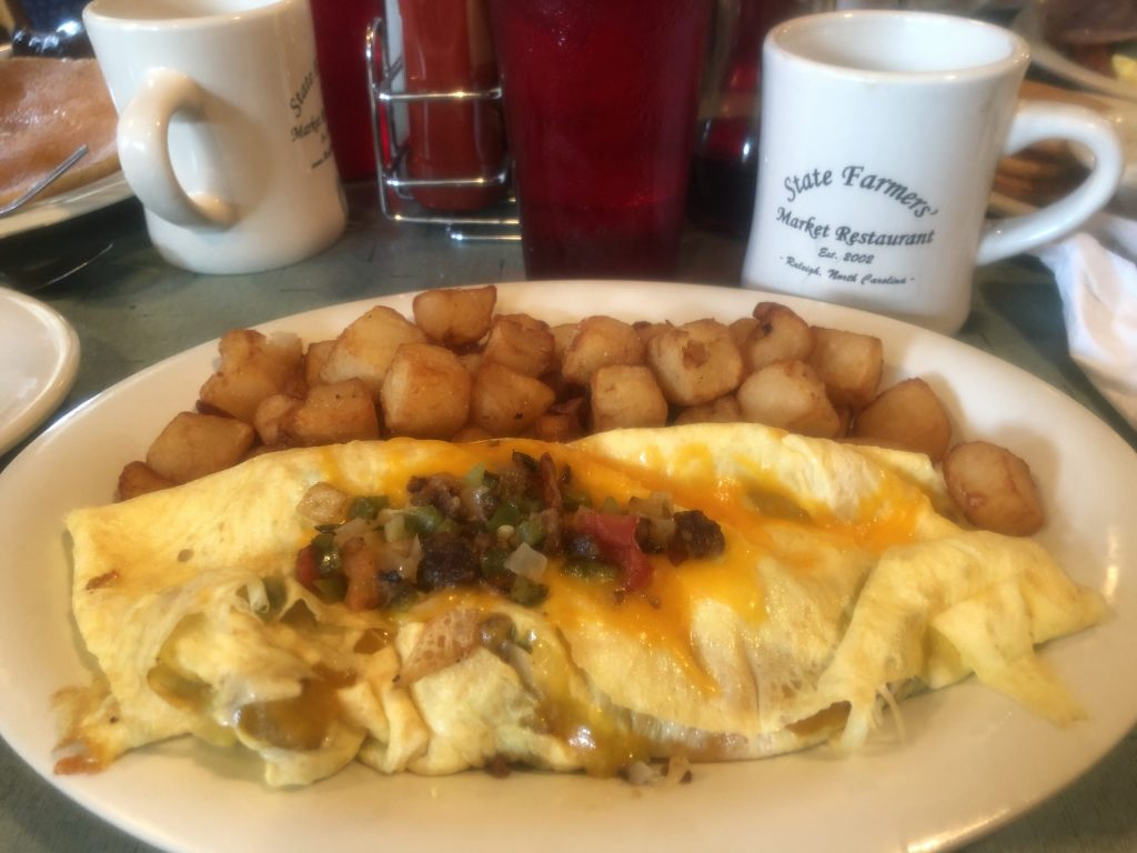 A huge western omlette with homefries.  The State Farmers Market in Raleigh is one of the best places to visit in North Carolina.