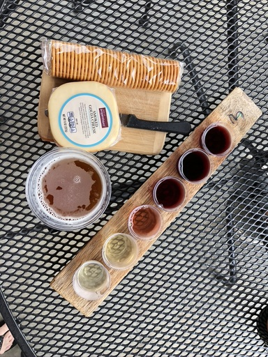 wine flight, glass of beer, and cheese and crackers