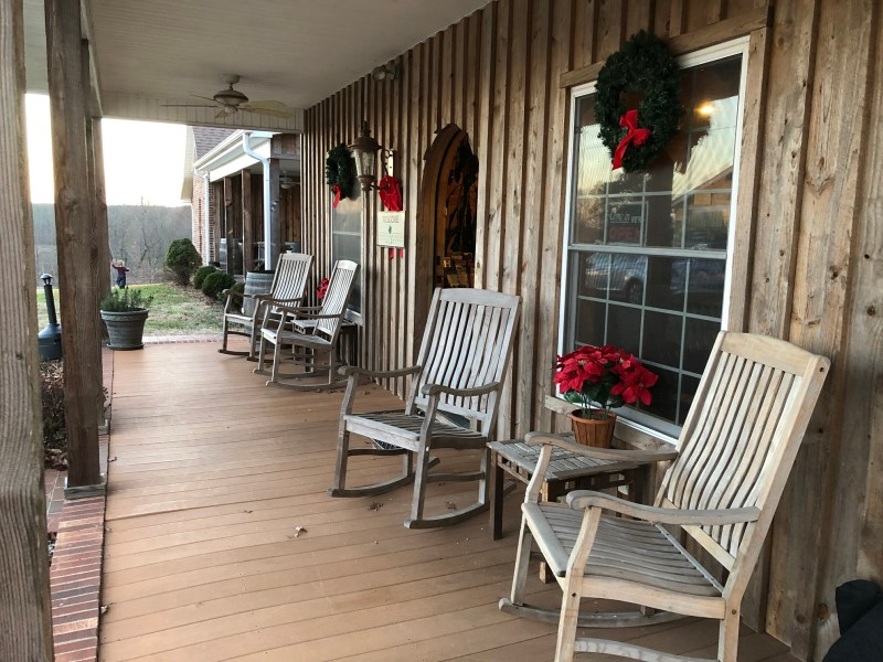 front porch with rocking chairs and Christmas decor at Carolina Heritage - yadkin valley wineries with lodging