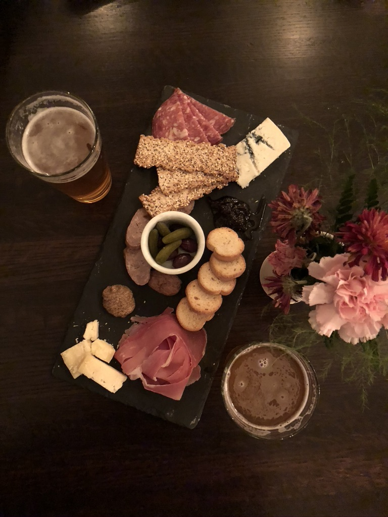 Charcuterie board and beer at Appalachia Kitchen. One of the best Snowshoe, WV Restaurants.