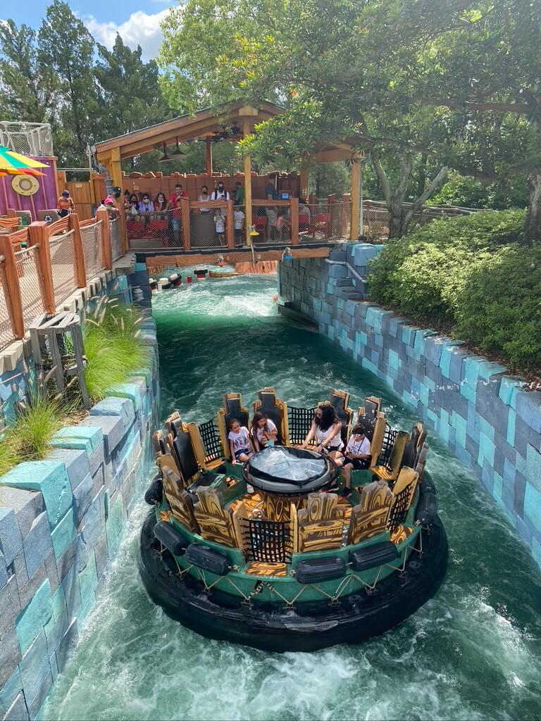 Circular barge on a water ride with bridge over the top