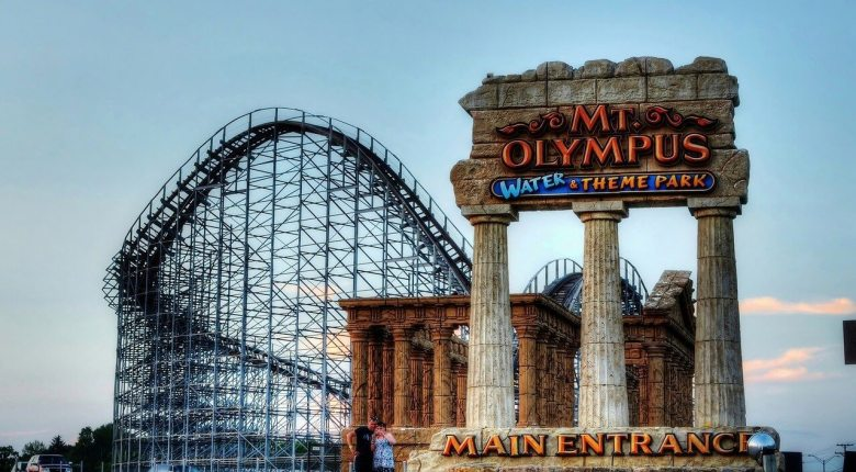 Mt. Olympus entrance sign with a roller coaster in the background