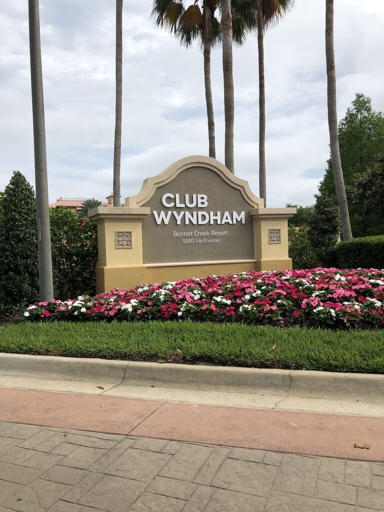 Club Wyndham Bonnet Creek entrance sign with flowers in front