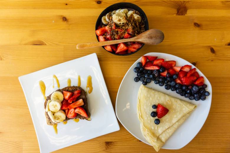 toast, crepe, and acai bowl with fruits