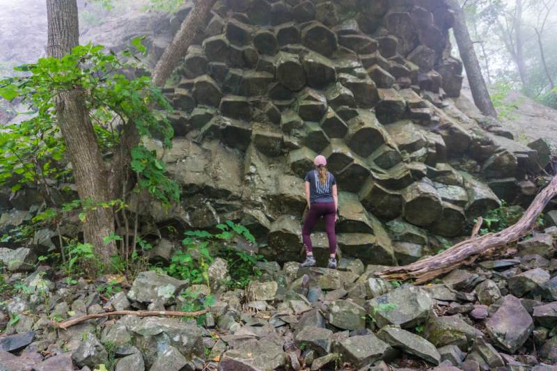 girl standing in front of rock formations