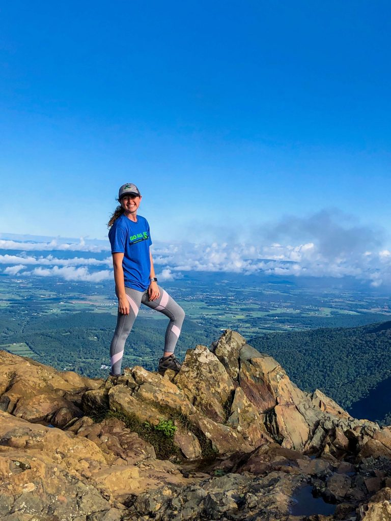 girl on top of rock formations - best hikes in Shenandoah