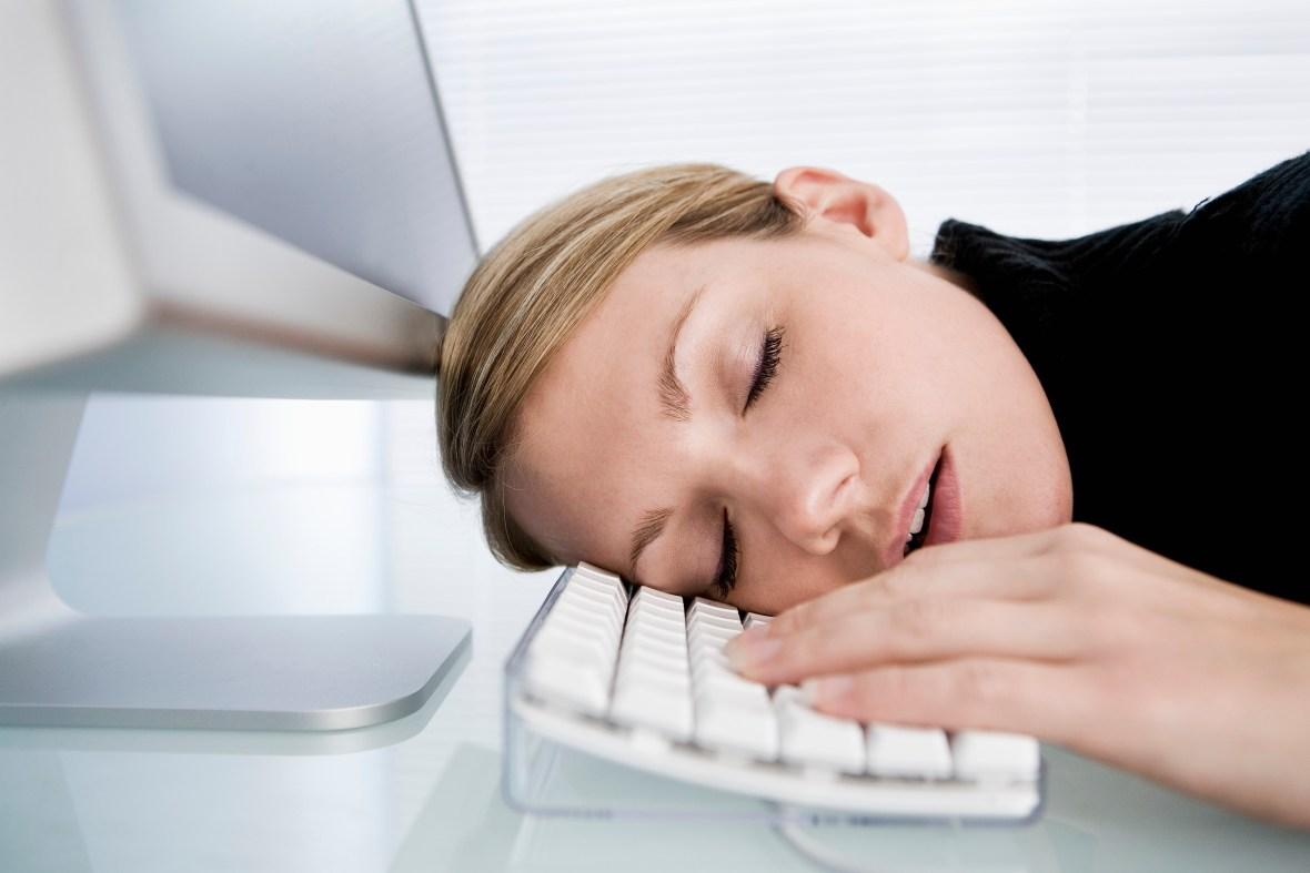 Woman Sleeping on Computer Keyboard
