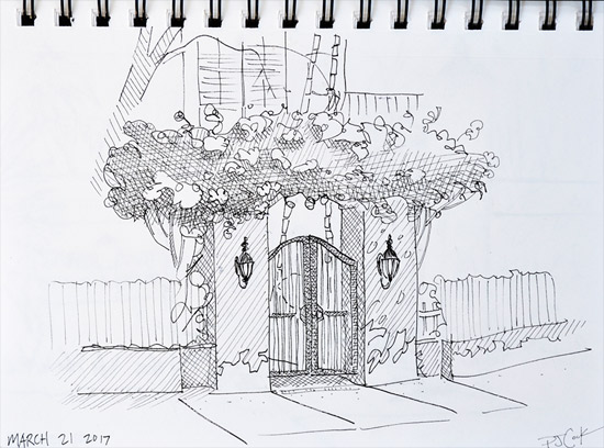 Pen and Ink drawing of a pretty gate done plein air in sketchbook.
