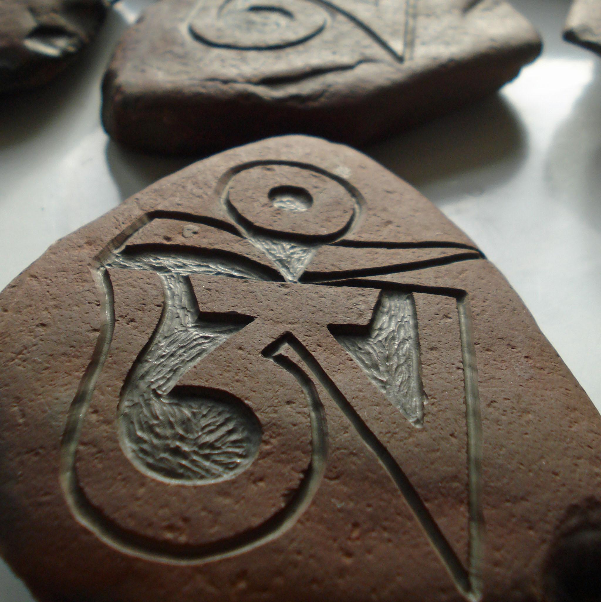 Hand Carved OM Stone Santosa